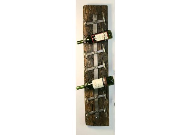 Iron seven bottle wall mounted wine rack image